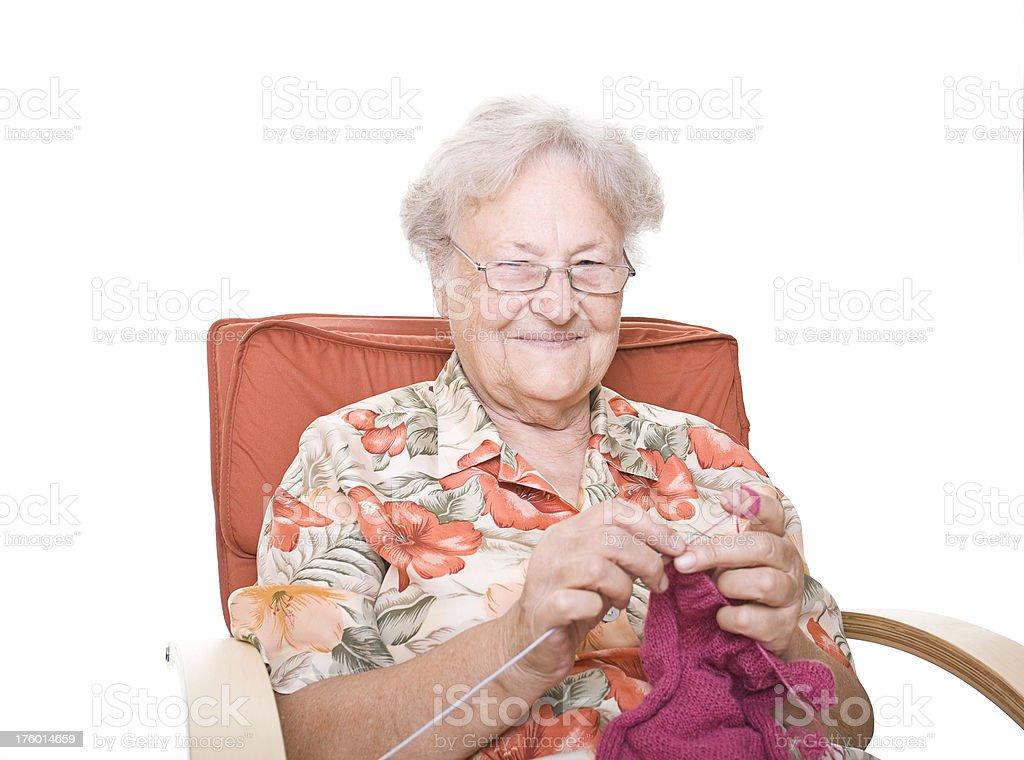 Senior lady knitting royalty-free stock photo