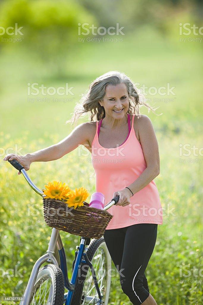 Senior Lady on Bicycle royalty-free stock photo