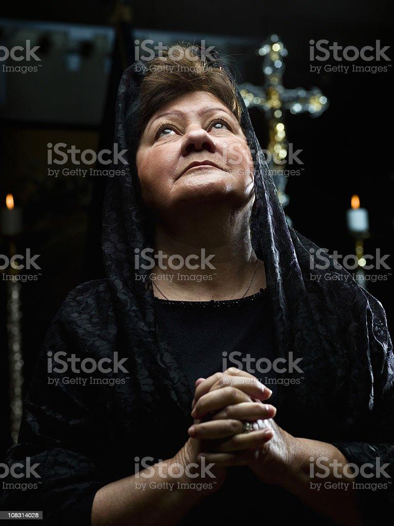 Senior Lady Praying at the Church royalty-free stock photo