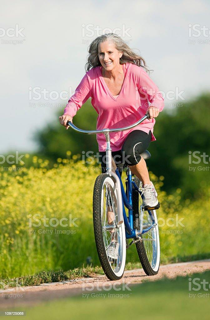 Senior Lady Riding Bicycle royalty-free stock photo