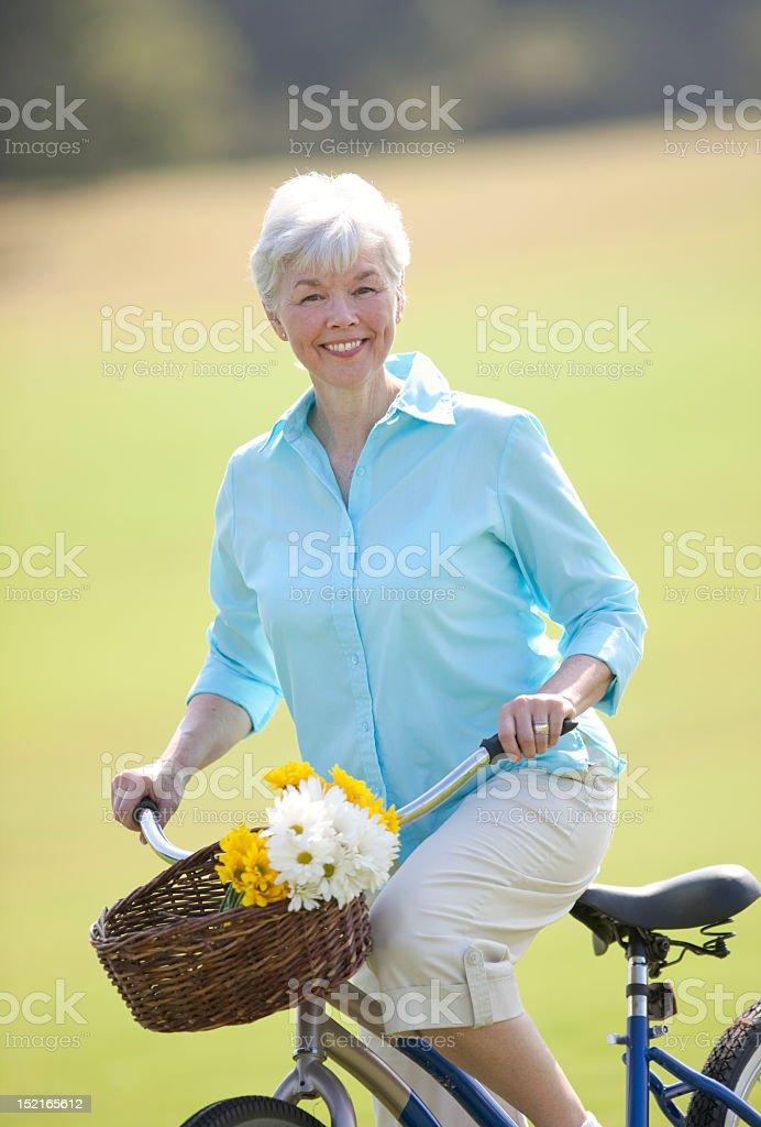 Senior Lady Sitting On Bicycle royalty-free stock photo