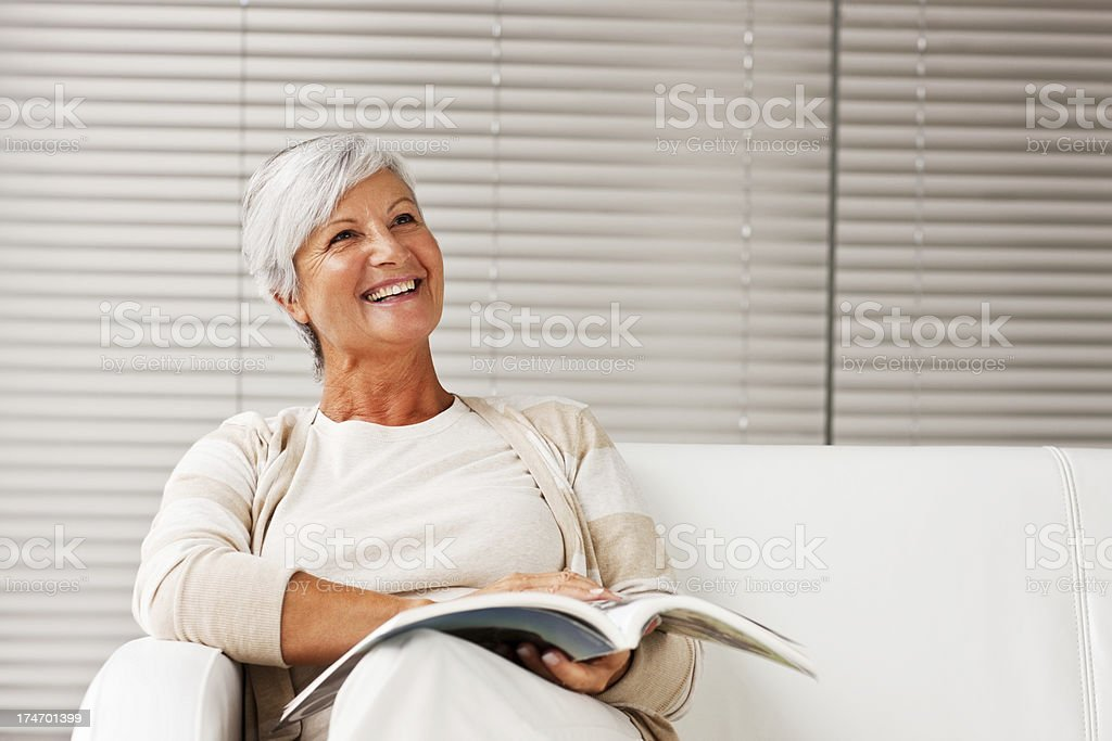 Senior lady smiling while looking at copyspace royalty-free stock photo