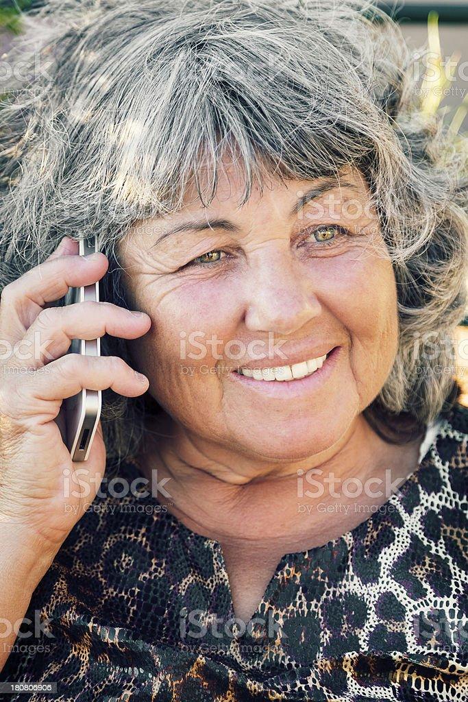 Senior lady talking on mobile phone royalty-free stock photo