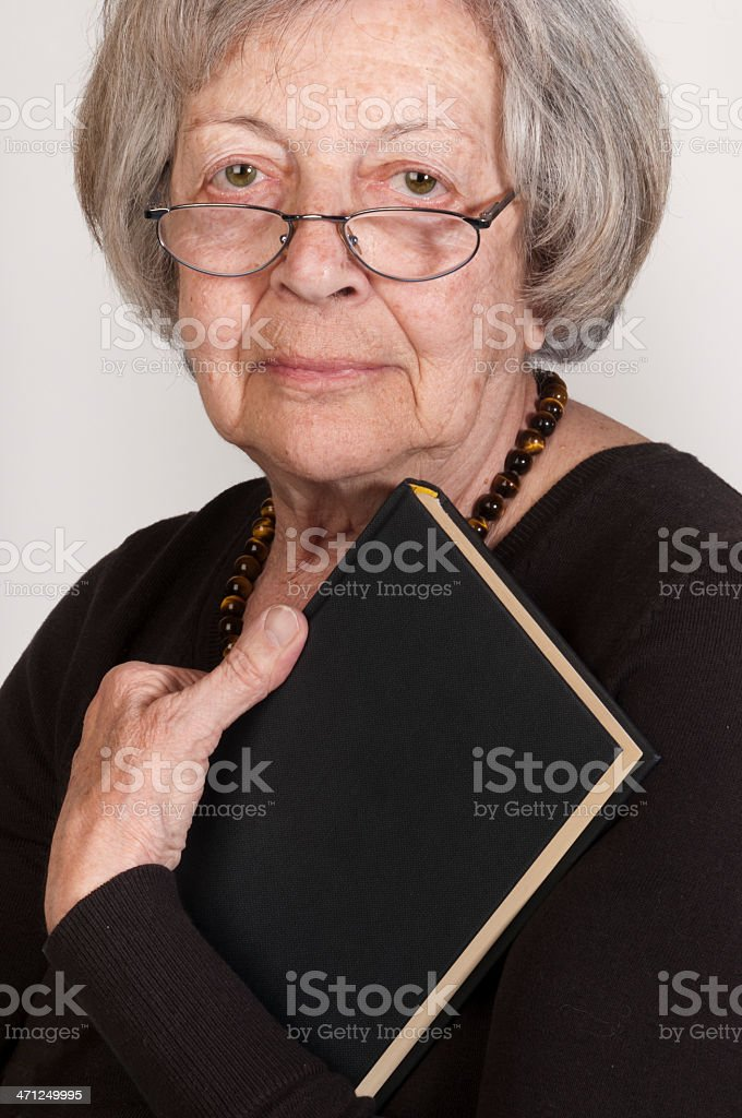 Senior lady with book royalty-free stock photo