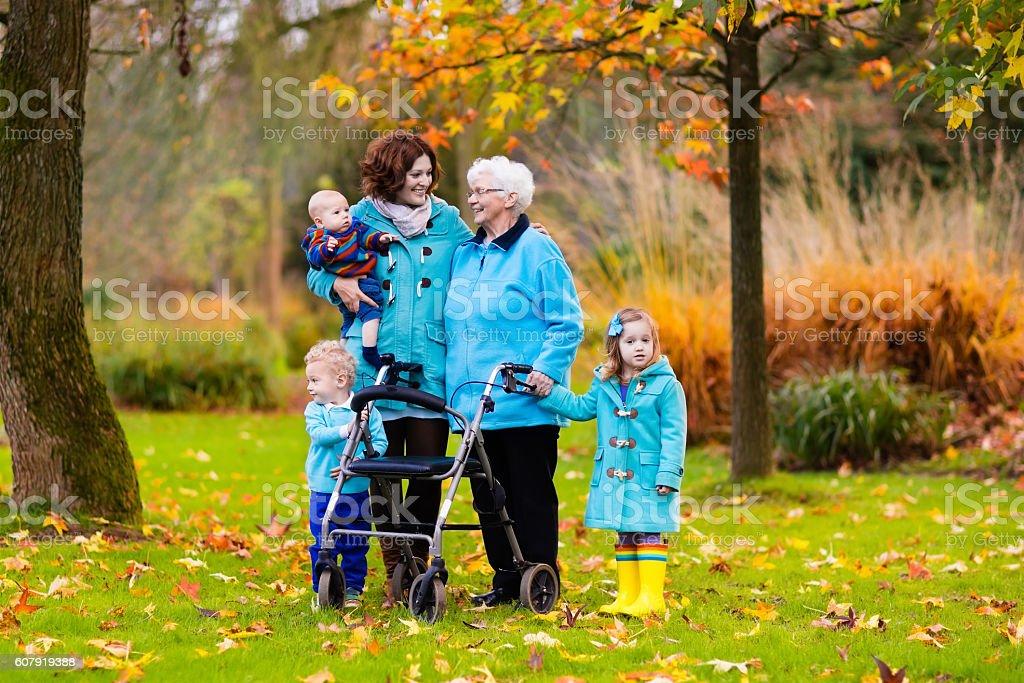 Senior lady with walker enjoying family visit stock photo