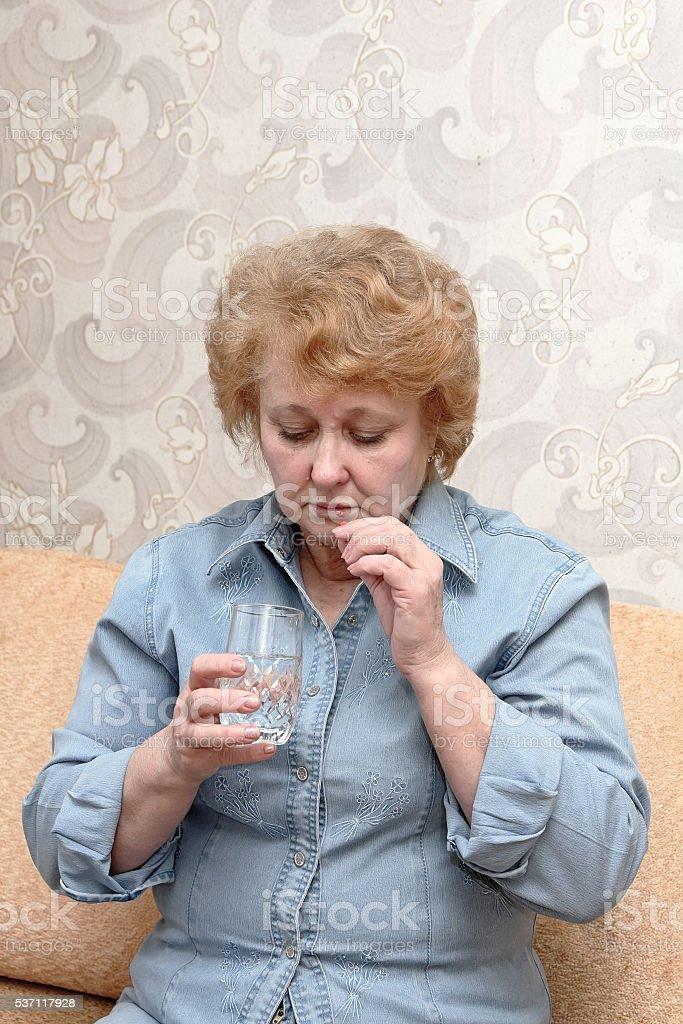 Senior lady woman with medication pills. stock photo