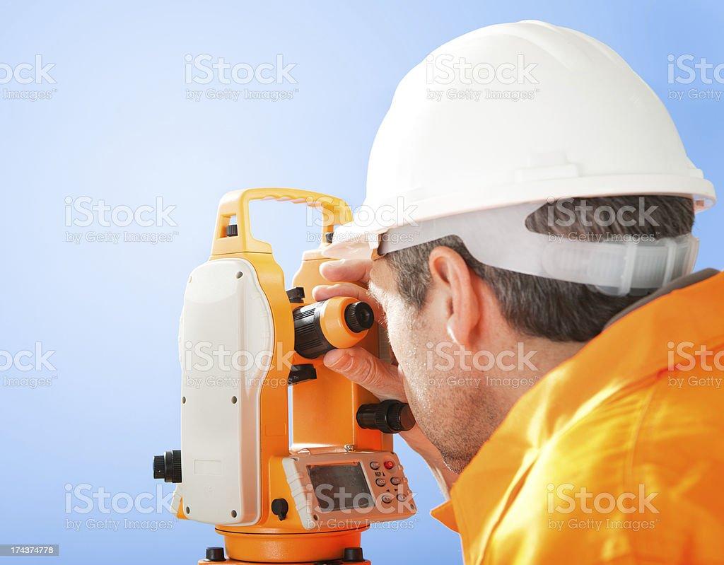 Senior land surveyor with theodolite royalty-free stock photo