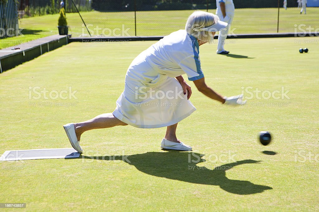 Senior lawn bowling on this sunny day stock photo
