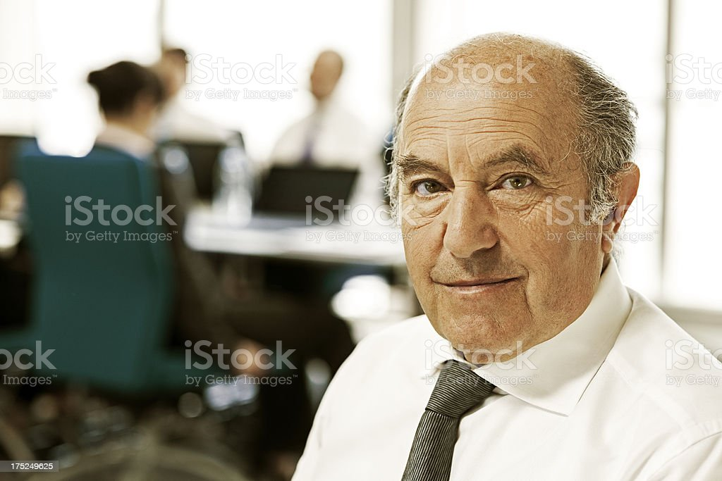 Senior leader with successful team royalty-free stock photo