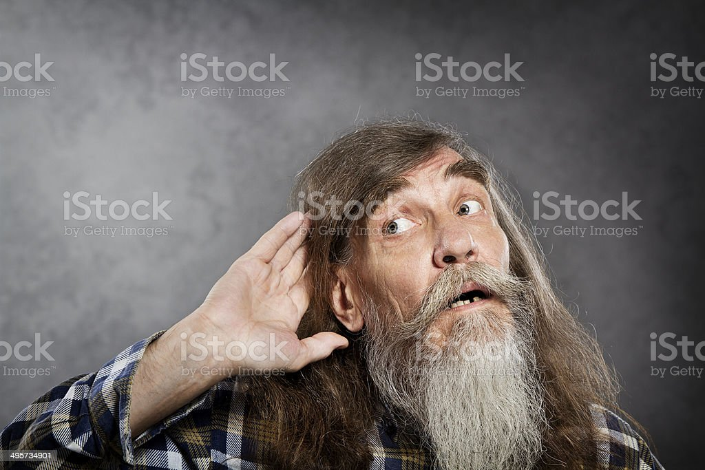 Senior listening, old man hold hand near ear. Deaf rumor stock photo