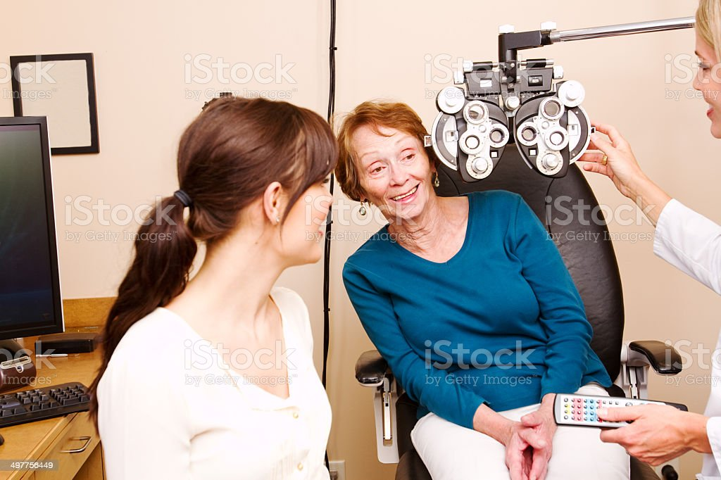 Senior looking out from behind optical machine stock photo