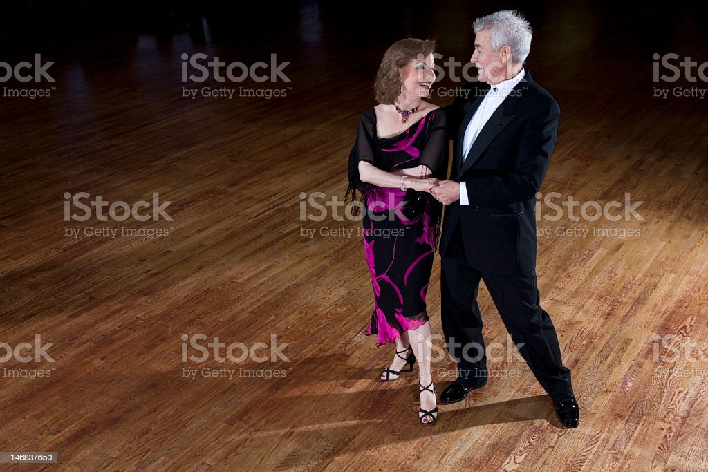 Senior male and female ballroom dancing stock photo