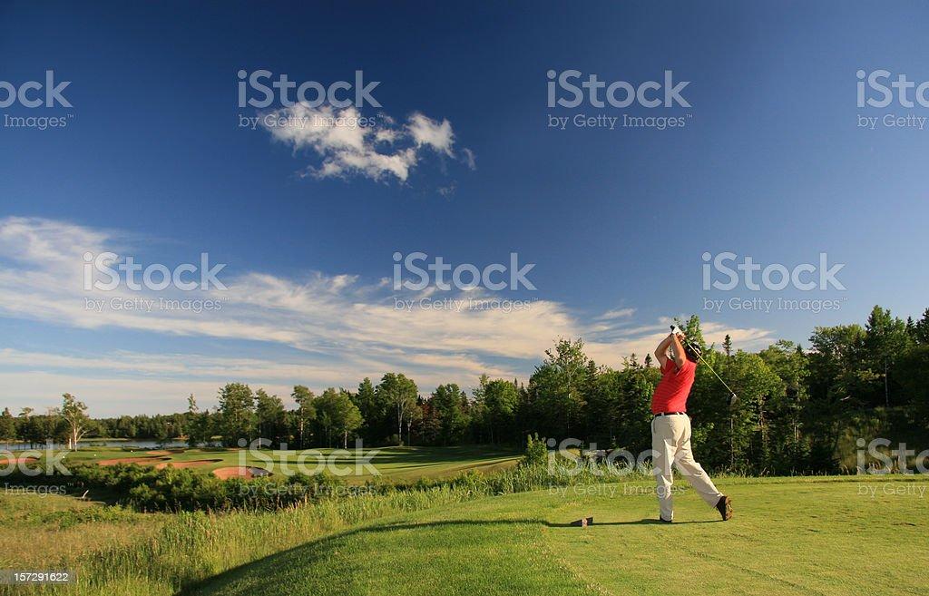 Senior Male Caucasian Golfer Hitting a Tee Shot stock photo