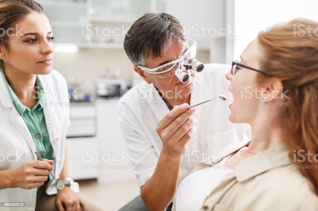 Senior male dentist stock photo