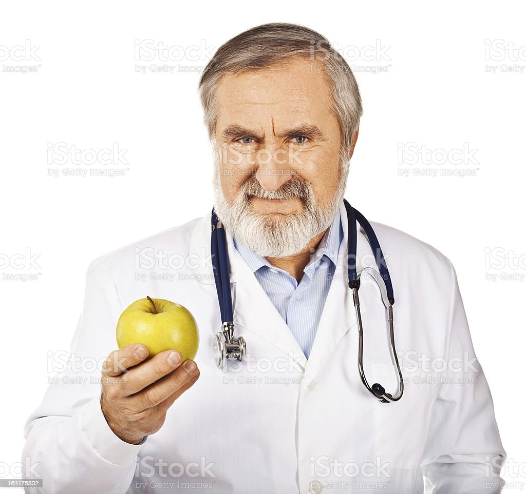 Senior Male Doctor holding apple royalty-free stock photo