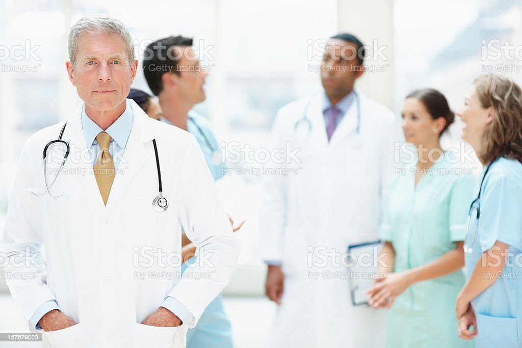 Senior male doctor in white lab coat royalty-free stock photo
