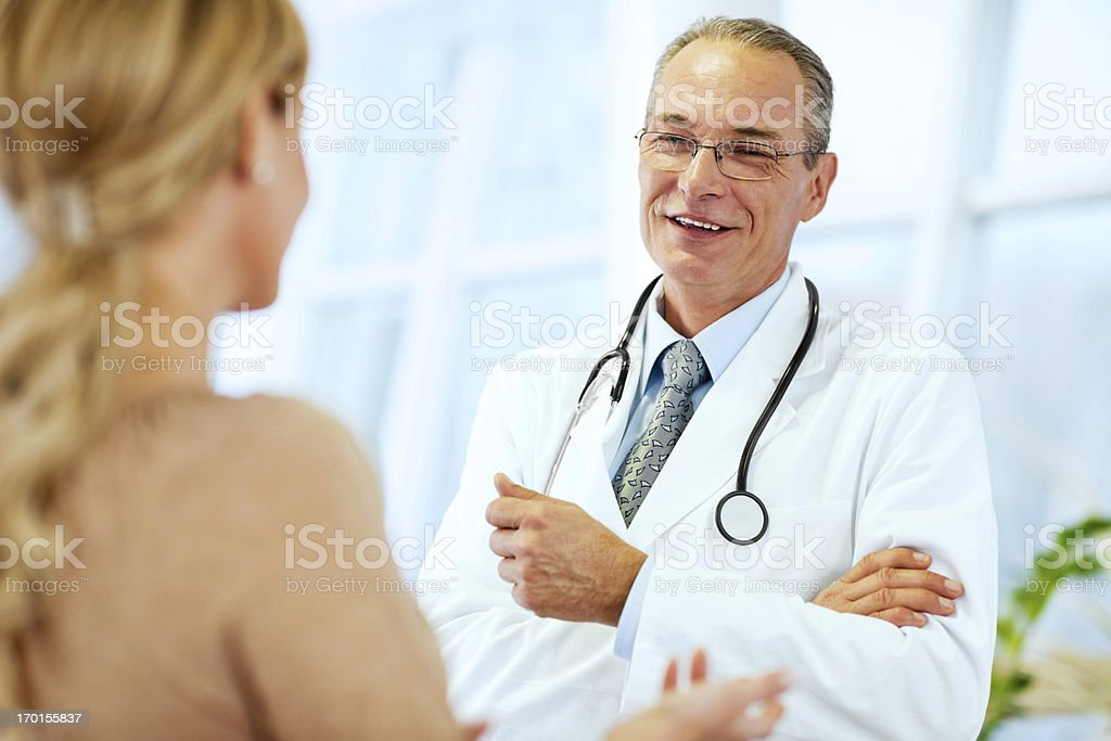 Senior male doctor talking with his patient. royalty-free stock photo