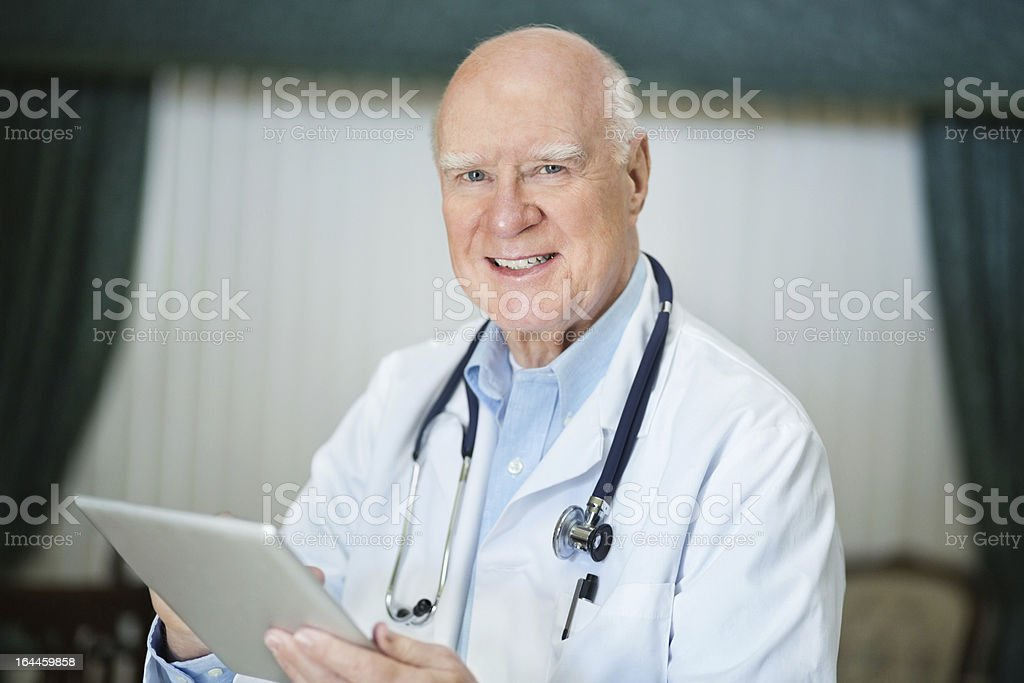 Senior Male Doctor With Digital Tablet royalty-free stock photo