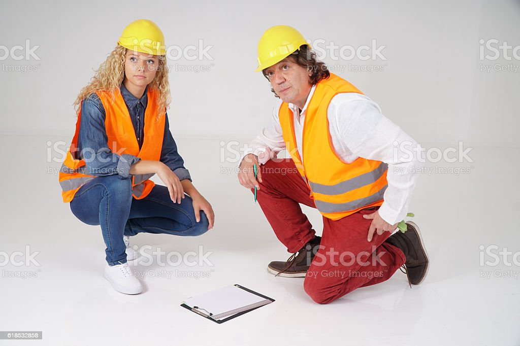 Senior male engineer and young female trainee stock photo