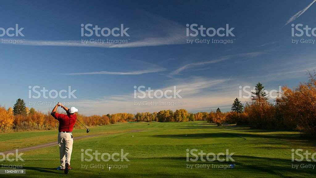 Senior Male Golfer in Autumn Golf Scenic stock photo