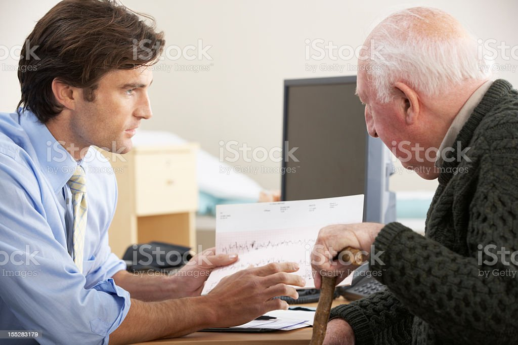 Senior male on a consultation with his doctor royalty-free stock photo