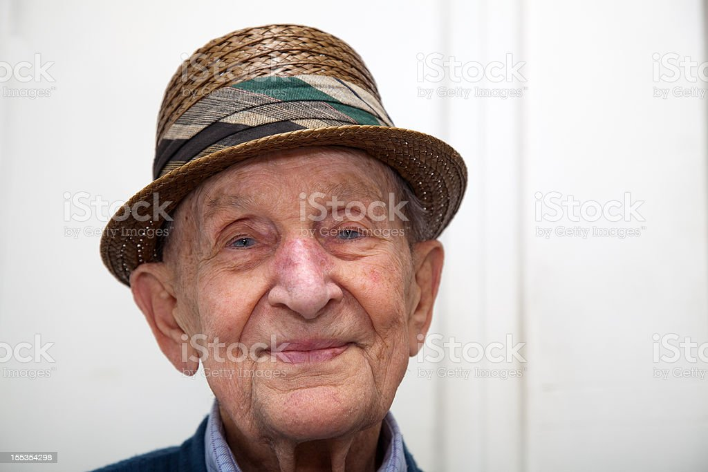 Senior male portrait 90 years old with straw hat royalty-free stock photo