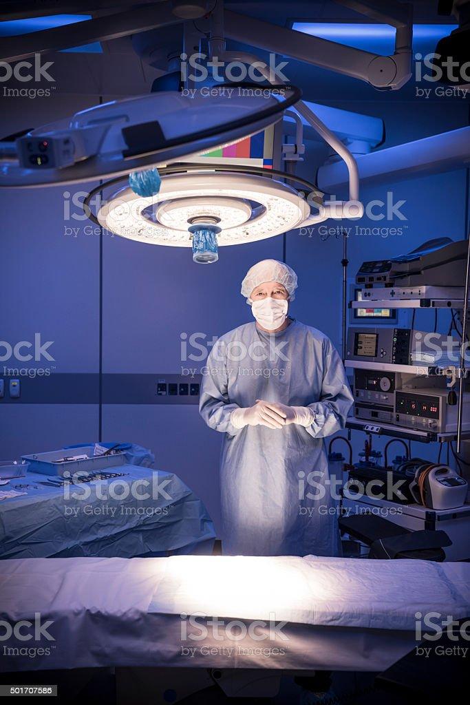Senior male surgeon wearing surgcial scrubs in operating theatre stock photo