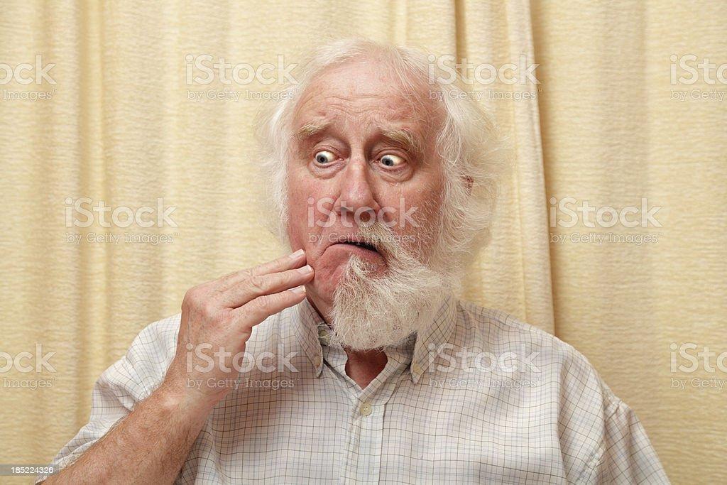 senior male surprised by vanishing beard stock photo