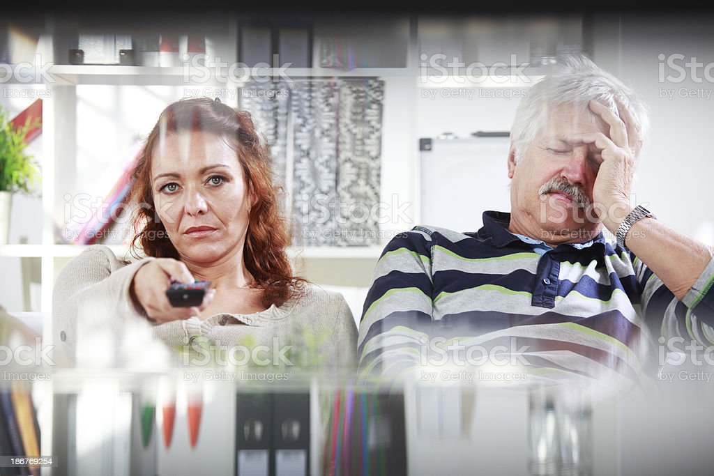 Senior man and female at home with problems royalty-free stock photo