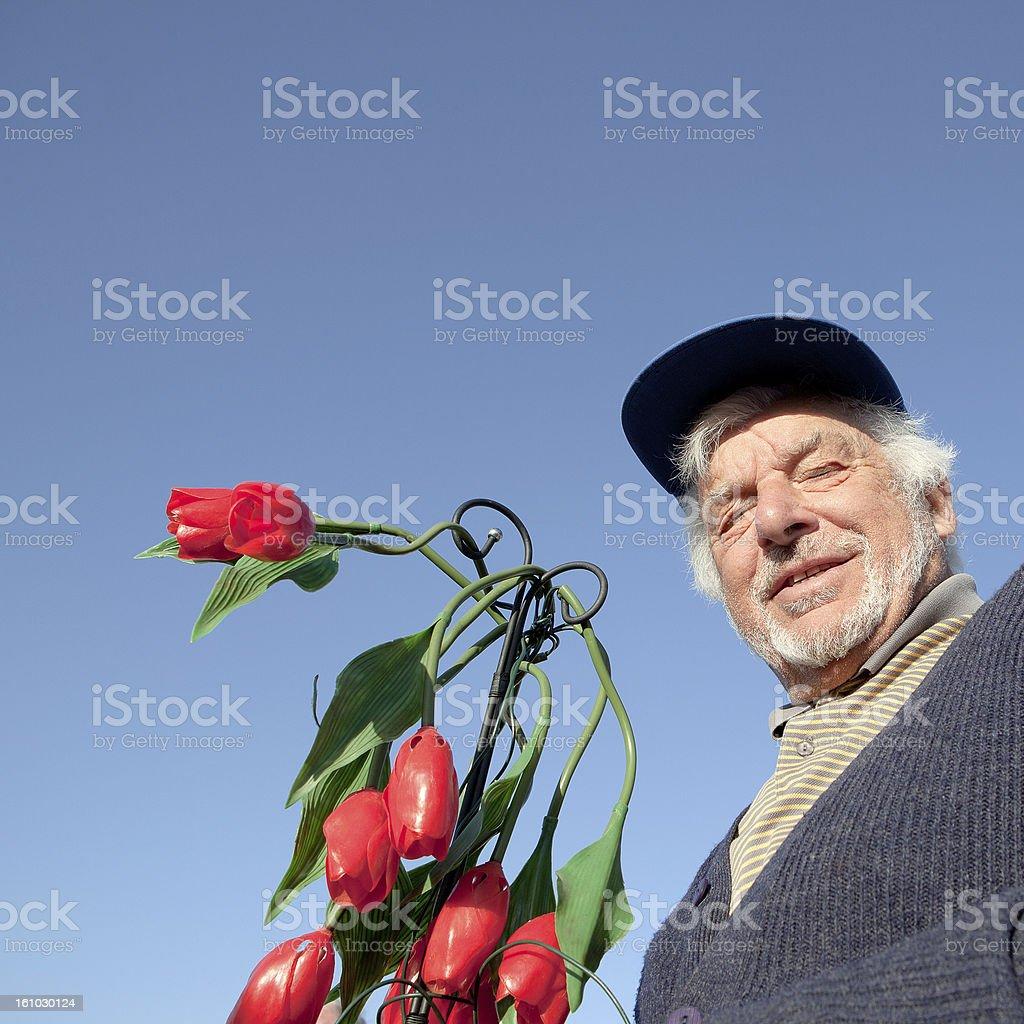 Senior man and flower royalty-free stock photo