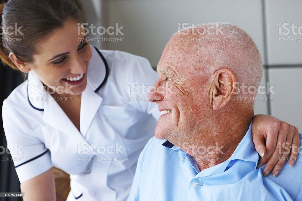 Senior Man and His Nurse stock photo