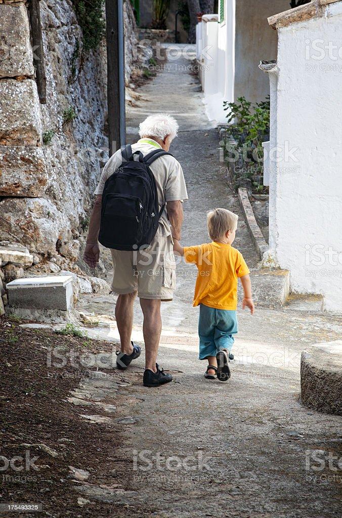 Senior Man And Little Grandson On Walk royalty-free stock photo