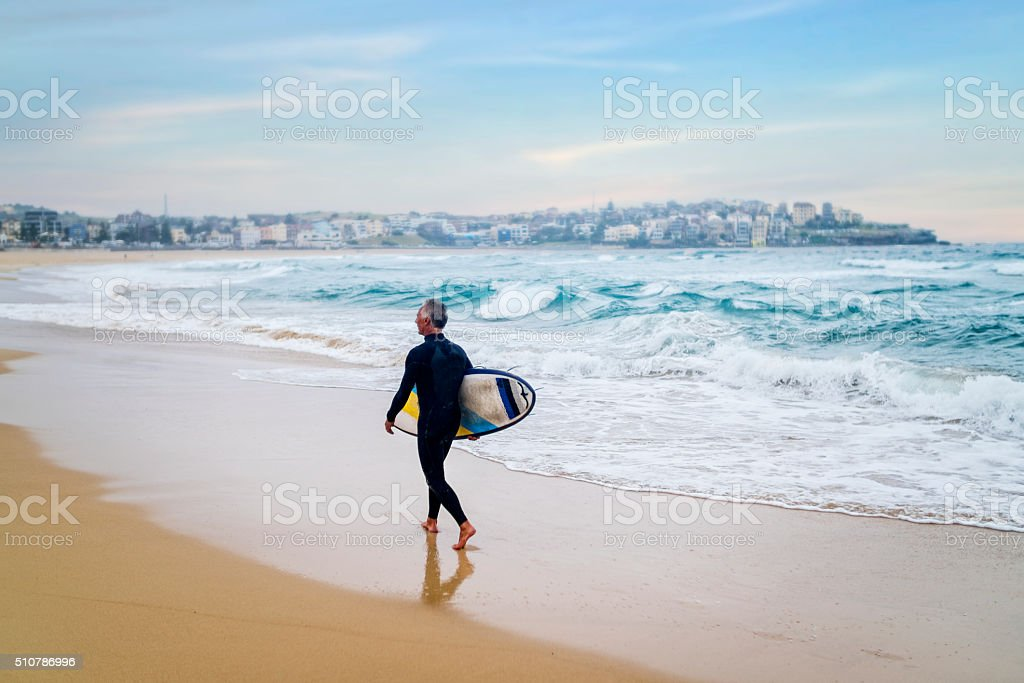 Senior Man and Surf Board stock photo