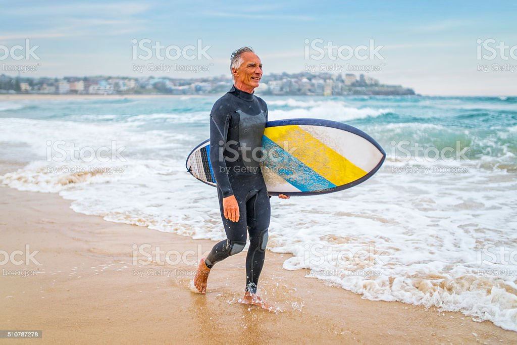 Senior Man and Surf Board stock photo
