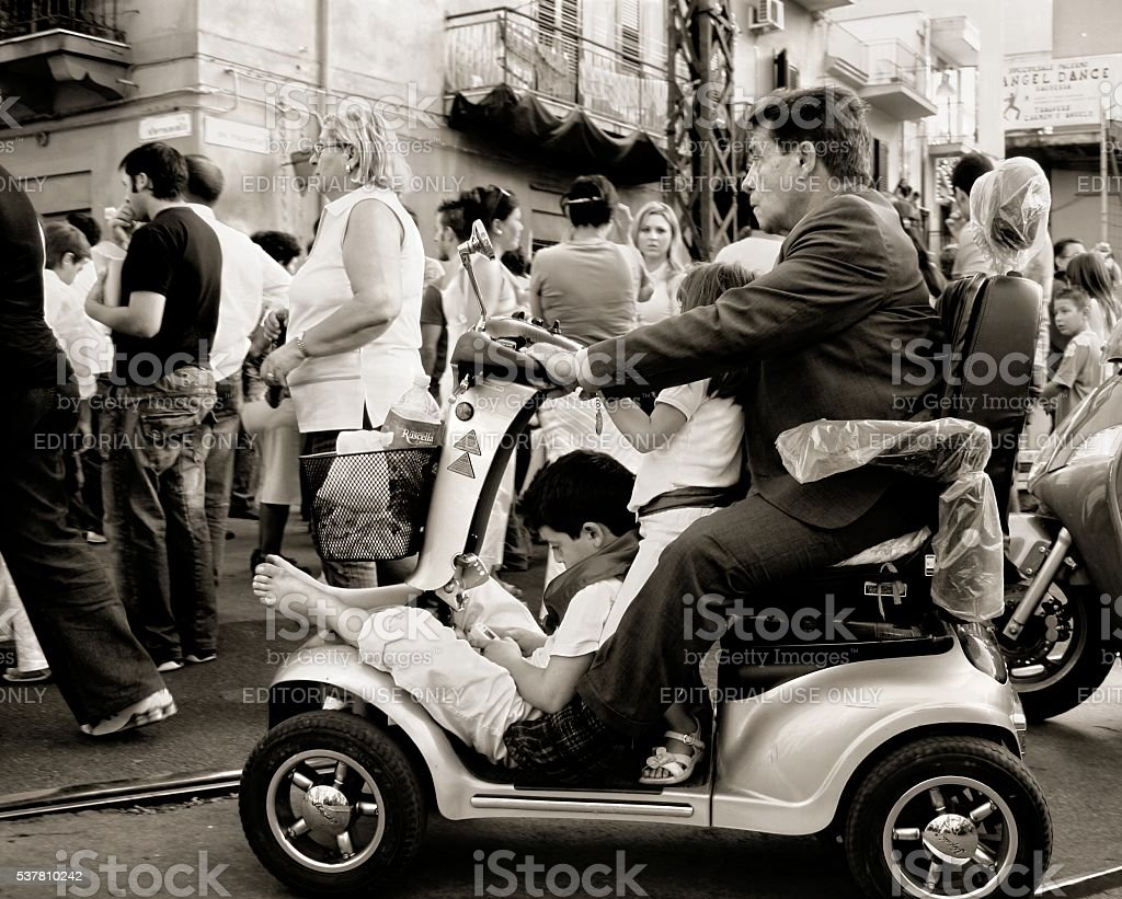 Senior man and two children on a quod Religious procession stock photo