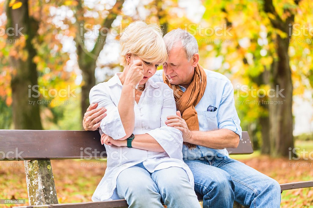 Senior man and woman being sad stock photo