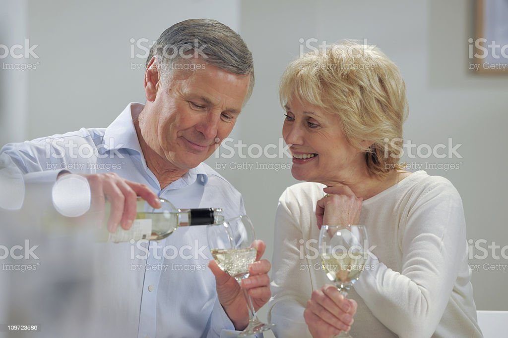 senior man and woman drinking wine royalty-free stock photo