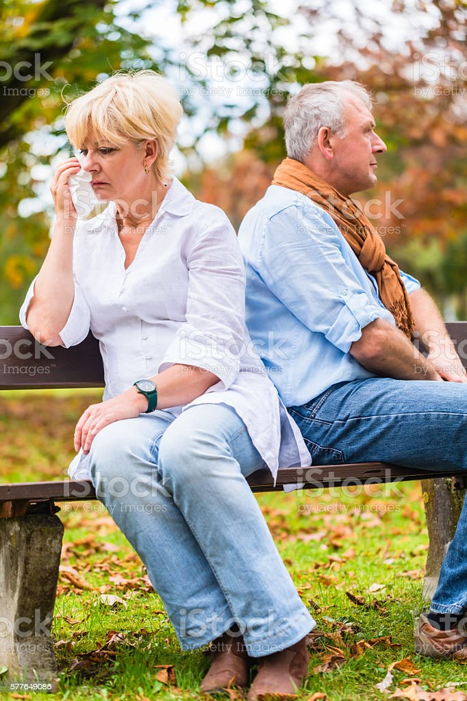 Senior man and woman having argument stock photo