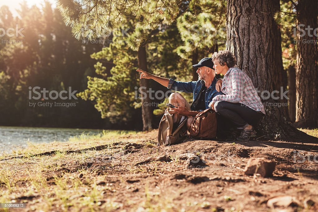 Senior man and woman on a hike in nature stock photo