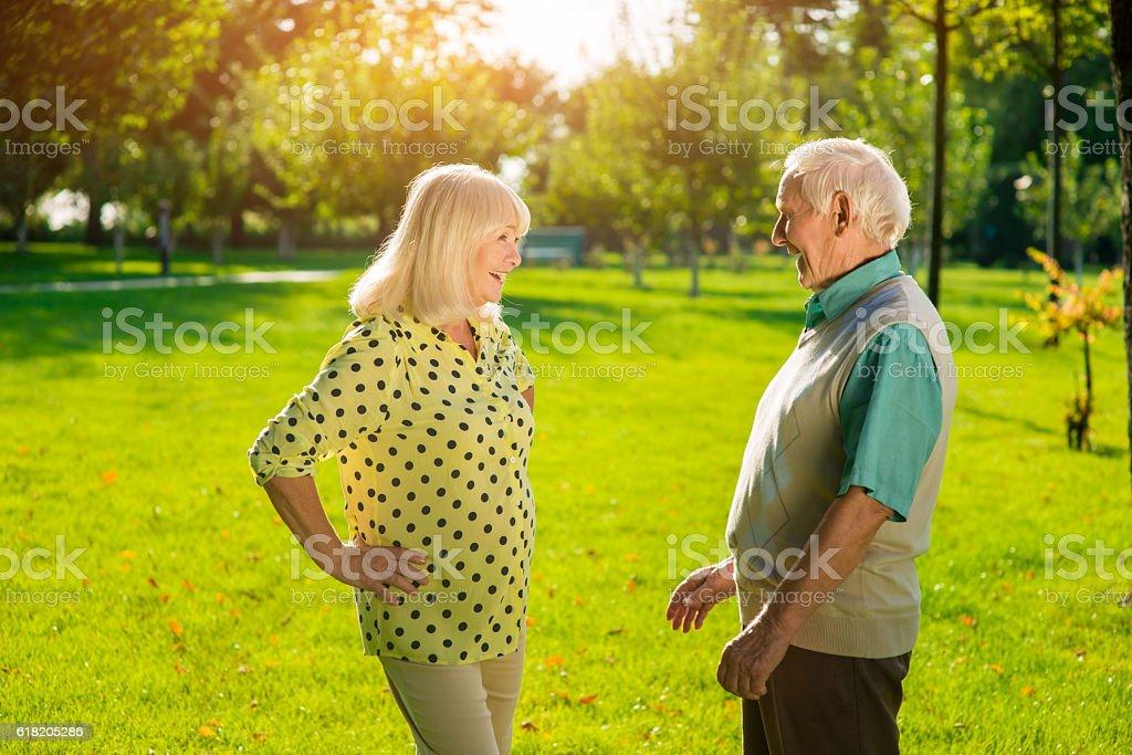 Senior man and woman outdoors. stock photo