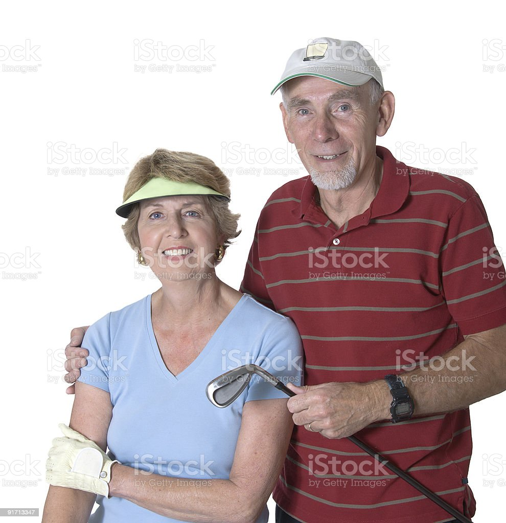 Senior man and woman ready for golf royalty-free stock photo