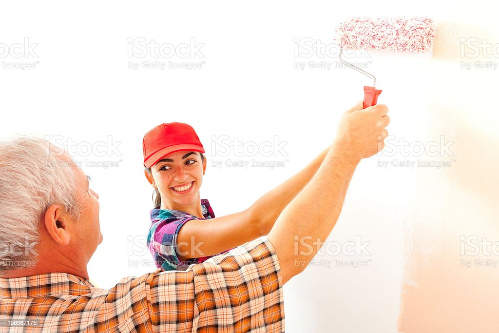 Senior man and young woman paiting home royalty-free stock photo