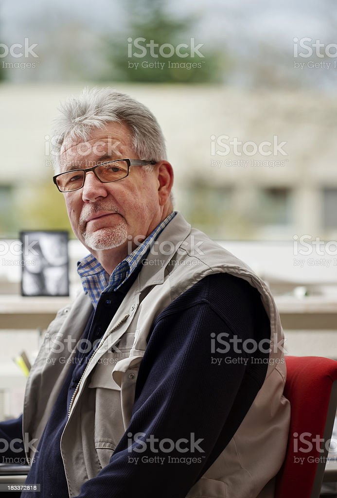 Senior Man at an Office Desk royalty-free stock photo