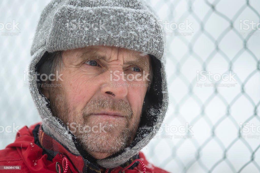 Senior Man at Camp Fence, Snowing, Julian Alps, Europe stock photo