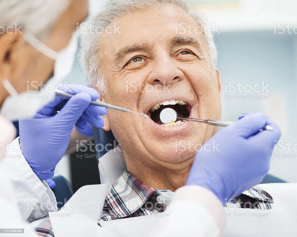 Senior Man At Dentist Office stock photo