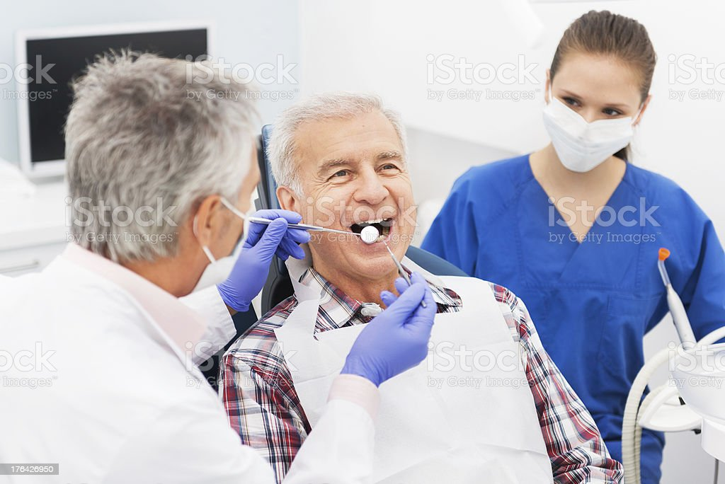 Senior Man At Dentist Office stock photo