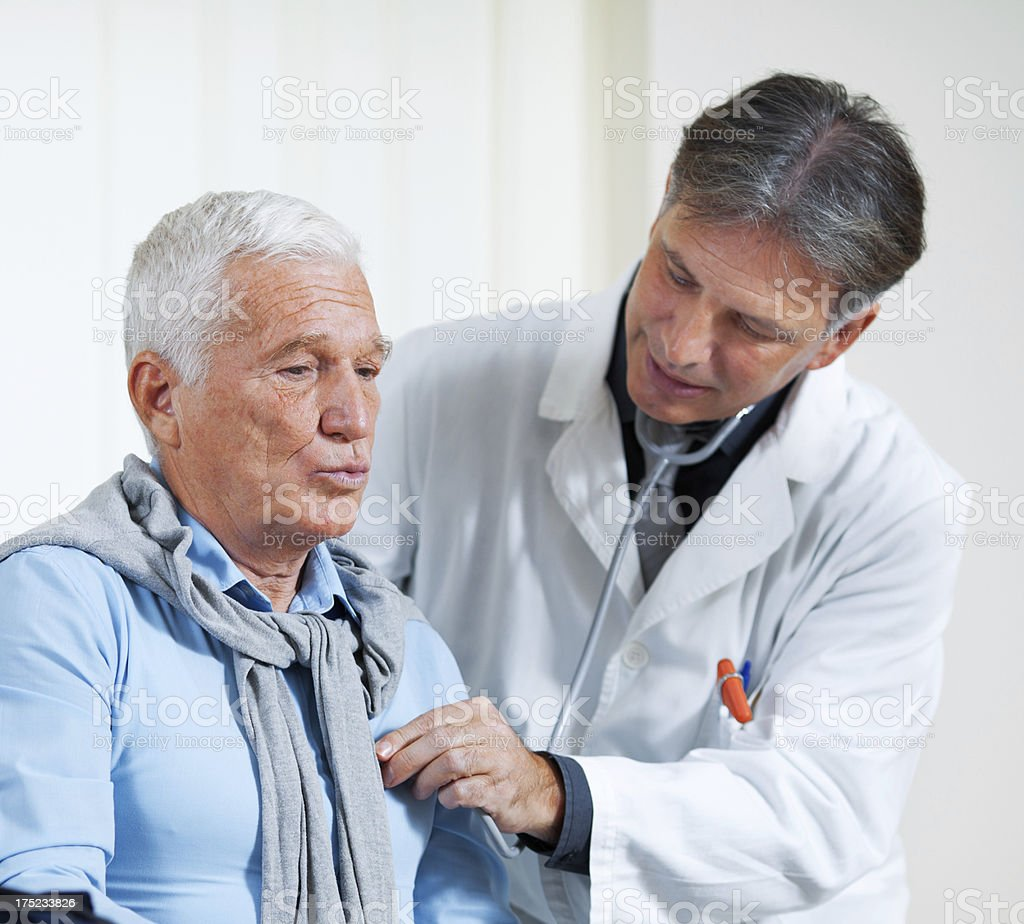 Senior man at doctor's office royalty-free stock photo