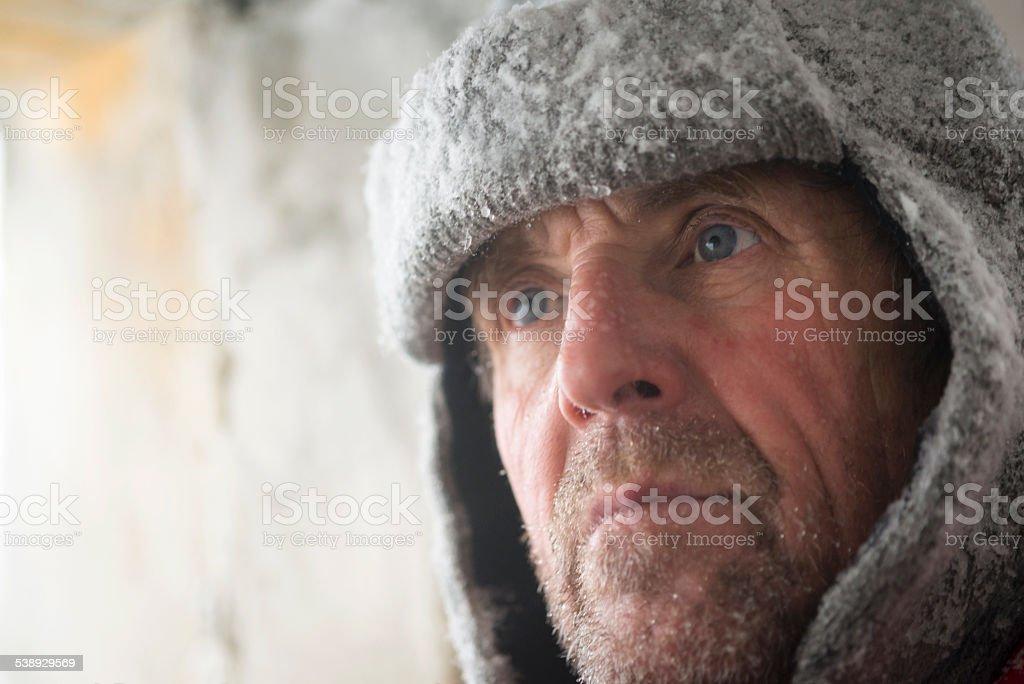 Senior Man at Great War's Bunker Porthole , Snowing, Alps, Europe stock photo