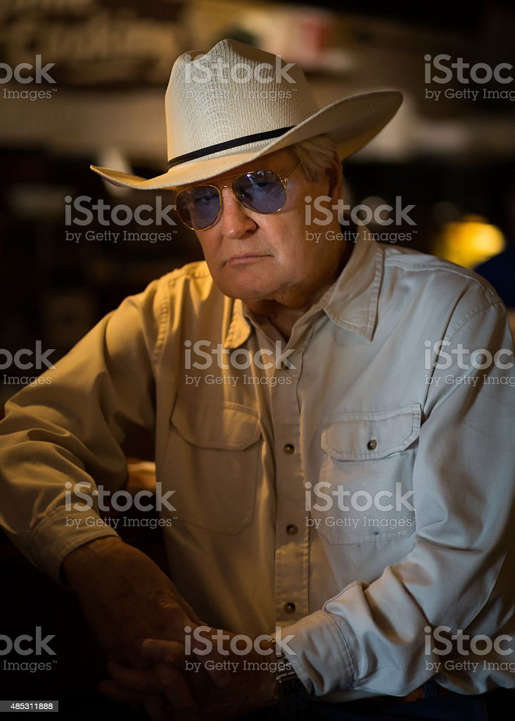Senior man at his fav restaurant stock photo