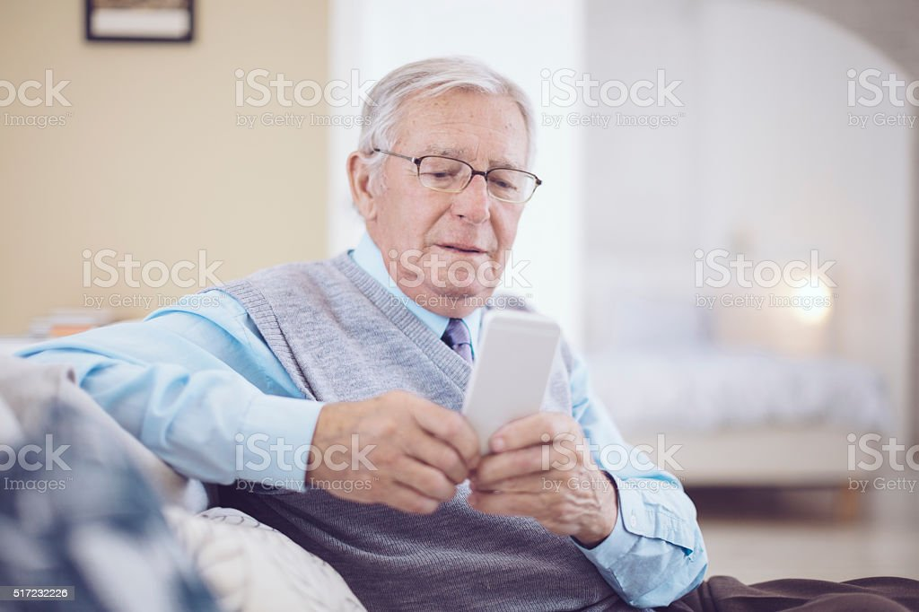 Senior man at home stock photo